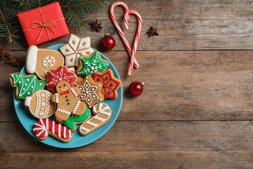 Fotobehang - Flat lay composition with tasty homemade Christmas cookies on wooden table, space for text