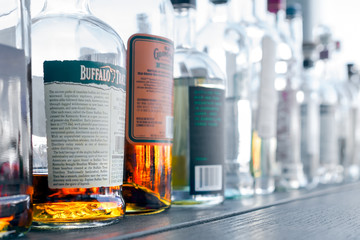 Whiskey bottles and other spirits lined up on a bar. Buffalo Trace and other brands in San Francisco on May 13, 2017