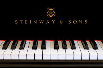 Steinway piano logo close up on black ebony grand in San Francisco on January 4, 2015