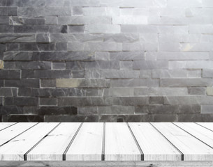 wood plank with abstract blur black stone brick wall background for product display