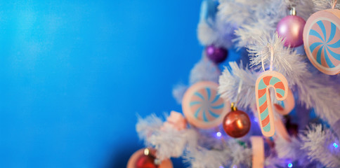 background made of christmas tree decorated with colored toys, copy space.