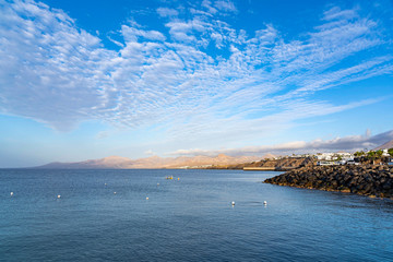 Beautiful clouds above the port of Puerto del Carmen during sunrise, Lanzarote, Spain
