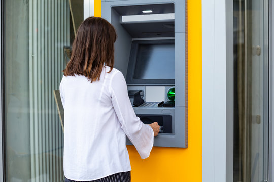 Young Woman Using Automatic Teller Machine