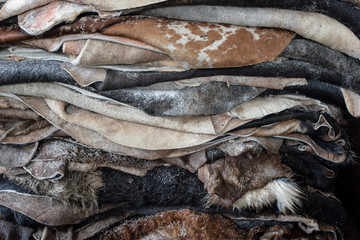 Pieces of raw leather stacked in tannery