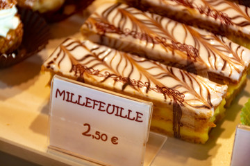 Freshly baked stuffed sweet Millefeuille pastries in traditinal French bakery in small village in Provence