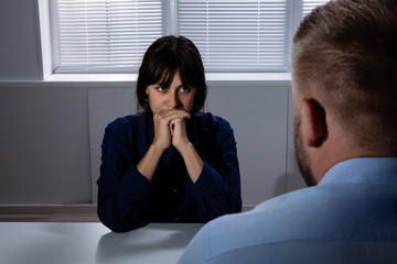 Close-up Of A Man Looking At Sad Woman In Room