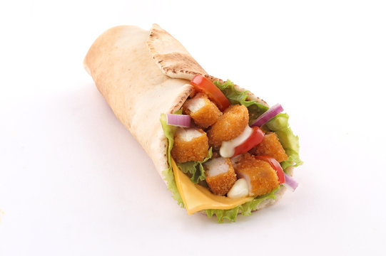 fried chicken tenders wrap pita bread with vegetables