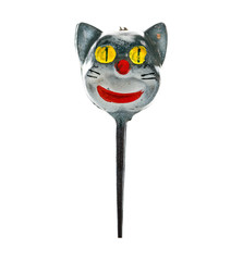 Macro of a vintage cake topper pick of a black cat head for Halloween