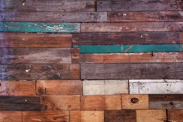 Texture of old worn and painted boards on a wall