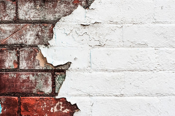 Texture of old peeling paint on a brick wall