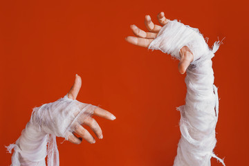 Halloween, costume image. The mummy's hand in bandages making gestures