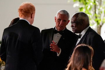 U.S. Vice President Mike Pence speaks with Supreme Court Justice Clarence Thomas during a state dinner for Australia's Prime Minister Scott Morrison in the Rose Garden of the White House in Washington