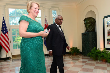U.S. Supreme Court Justice Thomas arrives with his wife for a State Dinner for Australia's Prime Minister Morrison at the White House in Washington