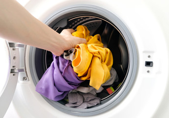 man's hand Pick up clothes Washing machine.Clean and Healthy Concepts