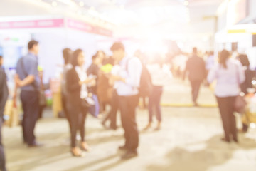 Blurred background of  public exhibition hall. Business tradeshow, job fair, or stock market. Organization or company event, commercial trading, or shopping mall marketing advertisement concept