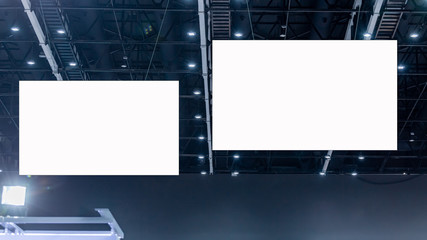 Fotomurales - White blank advertising billboard hanging on high ceiling background