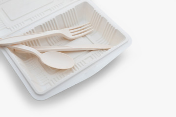 Fototapeta Biodegradable plastic lunch box, spoon and fork on white background isolate with clipping path obraz