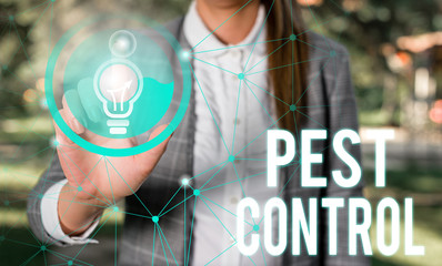 Handwriting text Pest Control. Conceptual photo Killing destructive insects that attacks crops and livestock Female human wear formal work suit presenting presentation use smart device