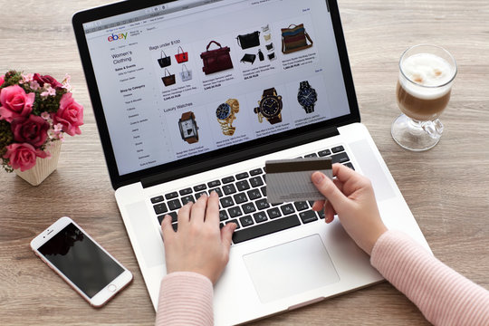 Woman with MacBook and iPhone Internet shopping service eBay