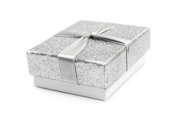 Small silver gift box on white.