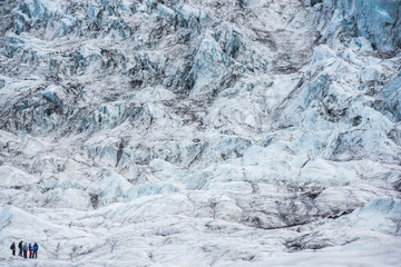 Wall Mural - People hike glacier in the summer