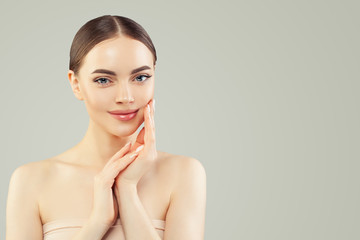 Cute spa model woman with clear skin. Skincare and facial treatment concept