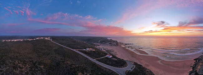 Panorama aerial from Monte Clerigo at the west coast in Portugal at sunset