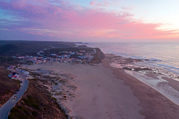 Aerial from Monte Clerigo at the west coast in Portugal at sunset