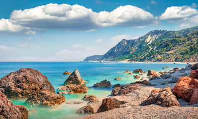 Stunning spring view of Avali Beach. Picturesque morning seascape of Ionian sea. Wonderful outdoor...