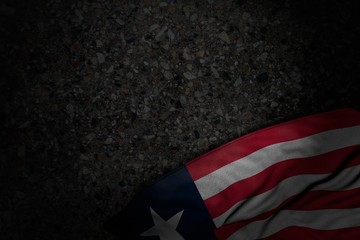 beautiful dark image of Liberia flag with large folds on dark asphalt with free place for text - any occasion flag 3d illustration..