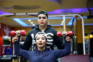 Iranian bodybuilder Sharareh Nobahari assists her fitness trainees at a gym in Tehran