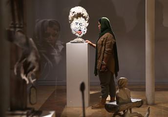 Iranian bodybuilder Sharareh Nobahari visits an art exhibition in Tehran