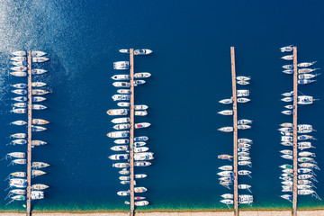 Fototapeta Aerial view of a marina with crytsal clear sea water