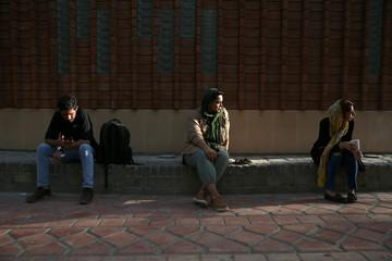 Iranian bodybuilder Sharareh Nobahari sits at a park in Tehran