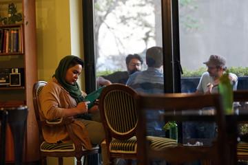 Iranian bodybuilder Sharareh Nobahari sits at a cafe in Tehran