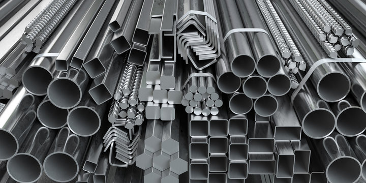 Different metal rolled products. Stainless steel profiles and tubes. in warehouse background.