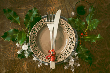 Christmas table setting for dinner with some natural winter decorations
