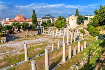 Wall Mural - Roman Agora in summer, Athens, Greece. It is a famous landmark of Athens. Panorama of Ancient Greek ruins near Plaka district. Landscape with historical remains of the old square of Athens city.
