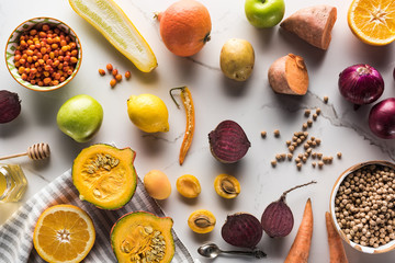 top view of season autumn vegetables, fruits and berries with chickpea on marble surface Wall mural