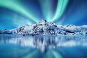 Photo sur Aluminium Aurore polaire Aurora Borealis, Lofoten islands, Norway. Nothen light and reflection on the lake surface. Winter landscape at the night time. Norway travel - image