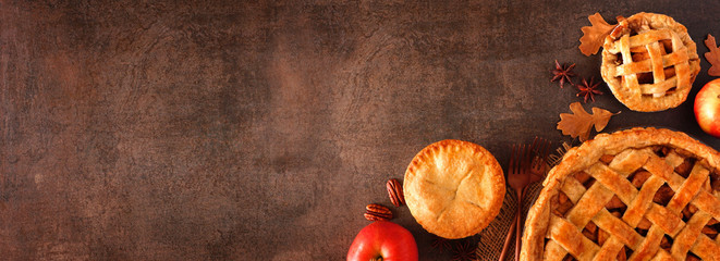 Printed kitchen splashbacks Autumn Homemade autumn apple pie corner border banner. Top view over a brown stone background with copy space.