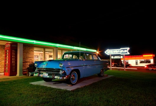 Springfield, Missouri - July 18, 2017. Springfield road arrow sign and retro car in Best Western Rail Haven motel. Famous motel on Route 66