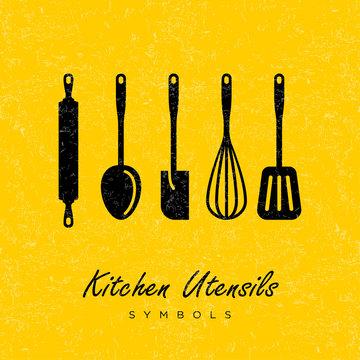 Black utensils silhouettes on an yellow background. Kitchen symbols icon.