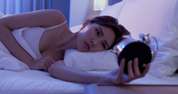 woman insomnia on bed
