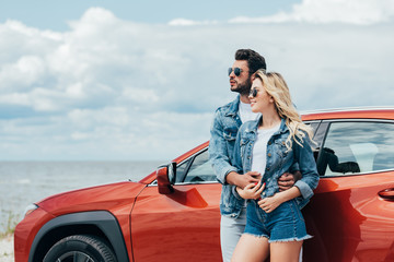 Fotomurales - attractive woman and handsome man in denim jackets hugging outside