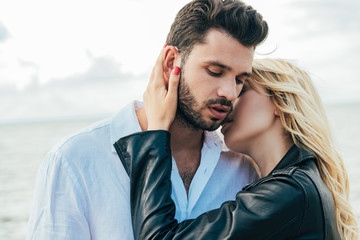 Fotomurales - attractive woman and handsome man smiling and hugging outside