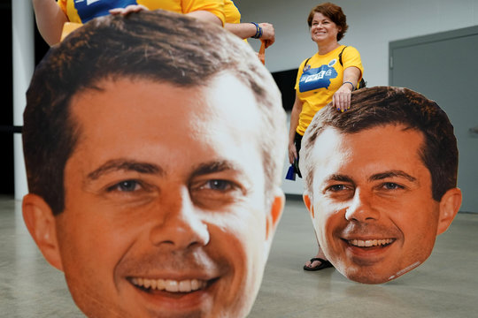 Two supporters hold large cutouts of Pete heads at a campaign event for Pete Buttigieg, South Bend Mayor and Democratic presidential hopeful in Newton