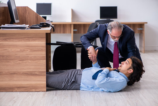 Male employee suffering from heart attack in the office