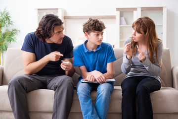 Concept of underage smoking with young boy and family