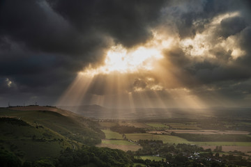 Recess Fitting Gray traffic Stunning Summer landscape image of escarpment with dramatic storm clouds and sun beams streaming down